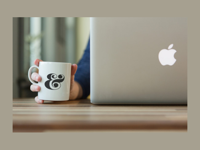 Free PSD Coffee Cup Mockup with Apple Macbook Pro
