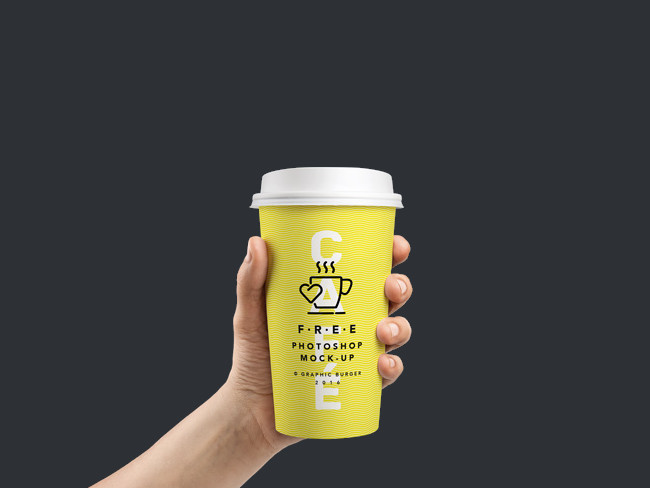 Photorealistic Coffee Cup In Hand PSD MockUp