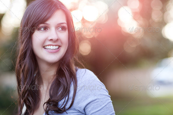 A portrait of a smiling beautiful woman