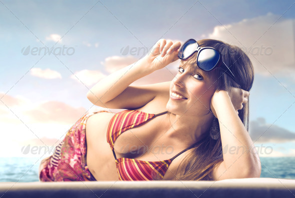 Beautiful Woman Lying on a Beach