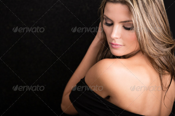 Beautiful woman with a backless dress
