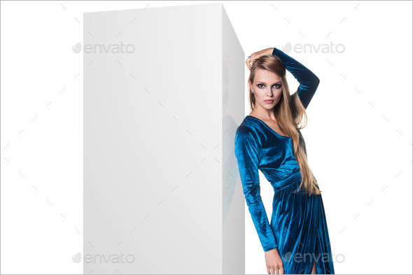 Fashion model leaned on white blank box picture