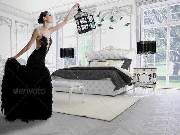 Glamorous Woman with a Cage in Modern Look
