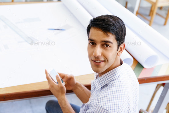 Young man in casual clothes in an office with drafts