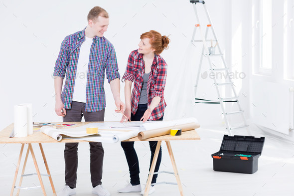 Man and the woman consulting the project