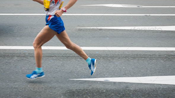 Marathon runners on the Road. Motion blurred