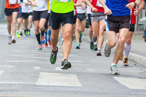 People Running in City Marathon for Designs