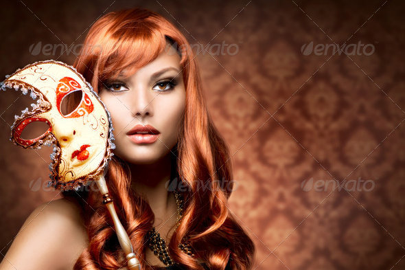 Romantic Look of Beautiful Woman with the Carnival Mask