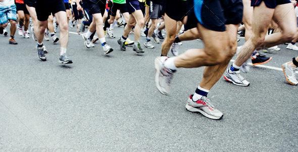 Runners running in city marathon