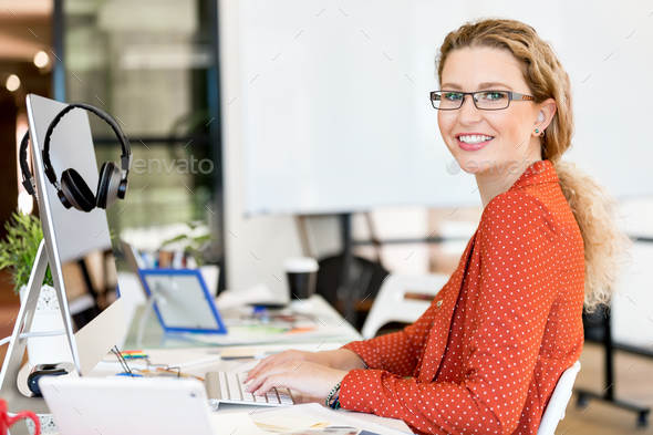 Young woman in casual clothes in an office