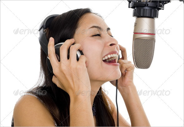 beautiful woman recording vocals in music studio, isolated on white background