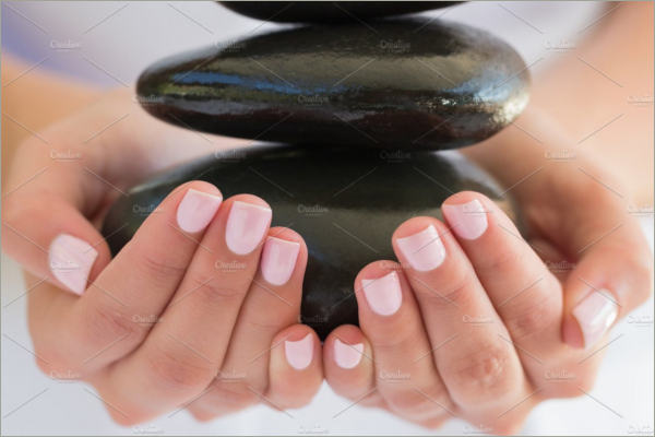 beauty therpist holding stones
