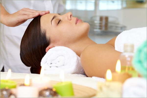 young woman receving facial massage