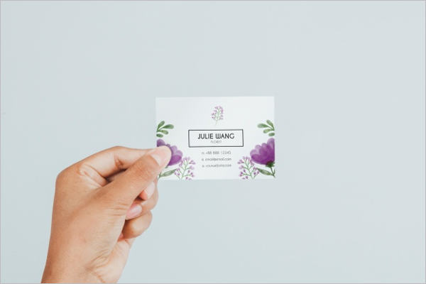 Hand Holding Business Card's Mockup