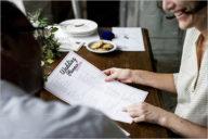Hands Holding Wedding Planner Checklist