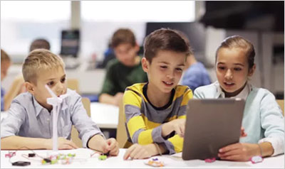 Kids with Tablet Pc Programming at Robotics School