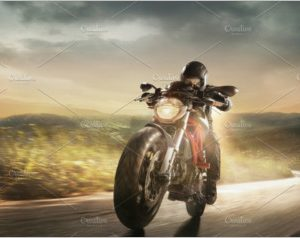 Motorcyclist in black helmet driving