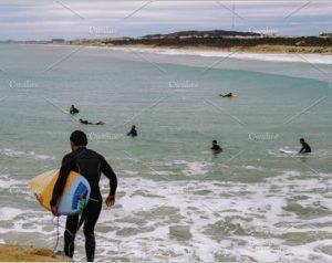Windsurfers on the breakwater