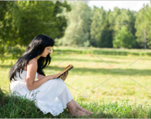 Girl with a book in the forest