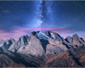 Colorful Milky Way over mountains