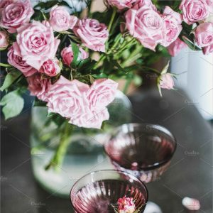 Champagne in Glasses and Pink Roses