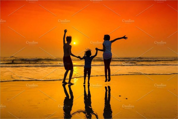 Dancing on the beach at sunset